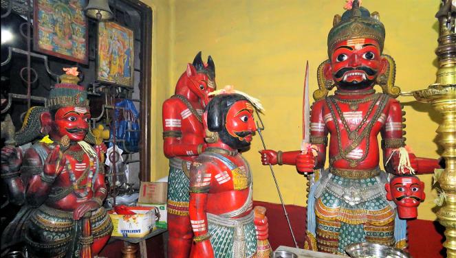 Wooden idols at the Mekkikattu temple