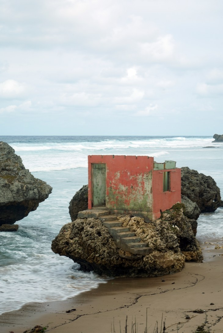 Changing house ravaged by surf
