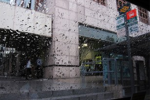 Raindrops falling on the surface of the taxi.