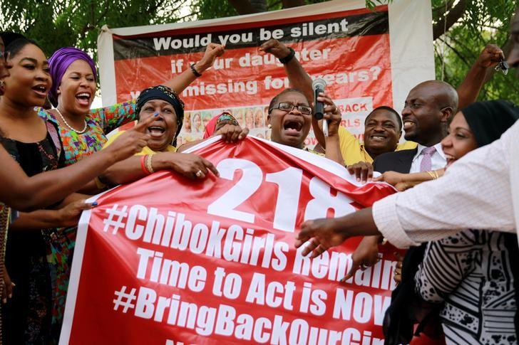 "Members of the #BringBackOurGirls (#BBOG) campaign react on the presentation of a banner which shows ""218"", instead of the previous ""219"", referring to kidnapped Chibok school girls, during a sit-out in Abuja, Nigeria May 18, 2016, after receiving news that a Nigerian teenager kidnapped by Boko Haram from her school in Chibok more than two years ago has been rescued. REUTERS/Afolabi Sotunde/Files"