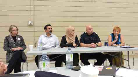 From left to right: Barbara Ursuliak, Sheldon Hughes, Fatmeh Kalouti, Sgt. Curtis Hoople, and Jan Fox talk about collaborative safety initiatives during the neighbourhood safety panel discussion.| Hamdi Issawi