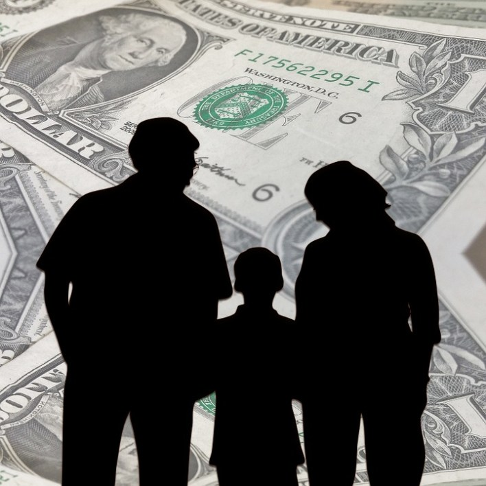 Father, Mother,and Son discussing family finances.