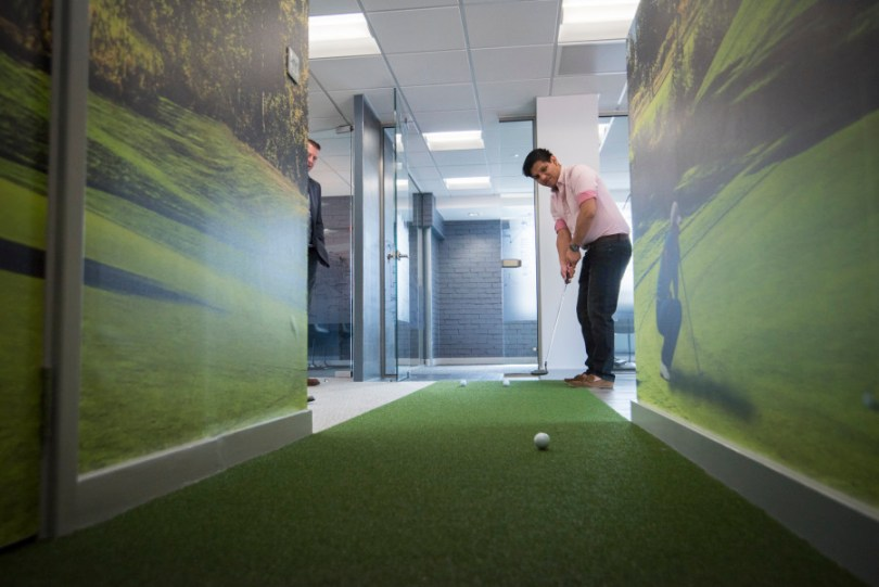 Putting green feature in office