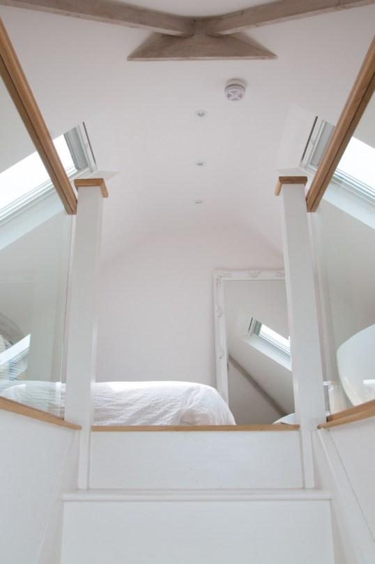 Stark white attic bedroom