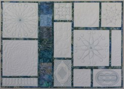 First ruler quilted table topper quilt
