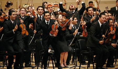 Simón Rattle leads the Simón Bolívar Youth Orchestra of Venezuela in an encore performance of Mambo!(The N.Y.Times)