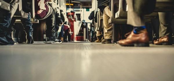 Bus floor showing passengers' feet.