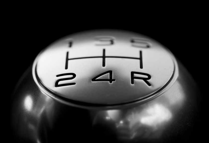 close up of gear shift over black background