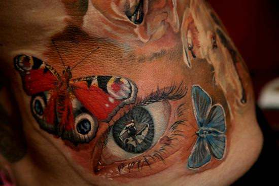 This Feminine Tattoo Of A Realistic Eye Surrounded By