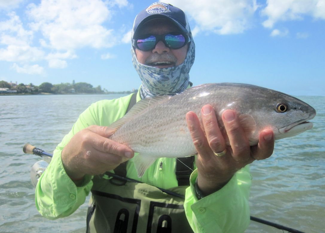 There should be good action in shallow water during March. Mike Perez, from Sarasota, caught and released this red on a Grassett Flats Minnow fly while wading Sarasota Bay with Capt. Rick Grassett in a previous March.