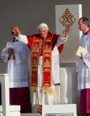Pope Benedict XVI waves to the crowd at the start of the Way of the Cross ceremony in central Madrid