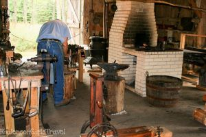 Blacksmith working with tools in shop