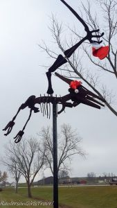 Metal Pterodactyl statue decorated for the holidays at Dinosaur Farm in Coloma, Michigan