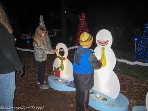 Children decorating snowman at Garden Glow at Missouri Botanical Gardens