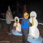 Children decorating snowman at Garden Glow at Missouri Botanical Gardens