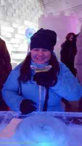 Heather Raulerson drinking an Appletini in the Aurora Ice Museum