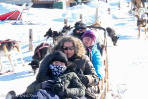 Four ladies bundled up for dog sledding with their cameras
