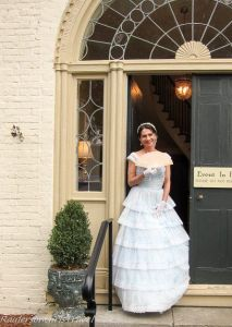 Southern belle posing for a photo in a doorway Twickenham Historic Homes
