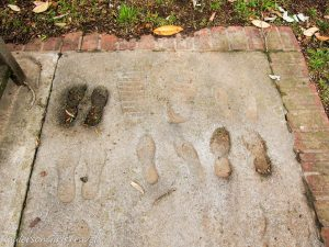 imprints of students following Alan B. Shepard's foot prints