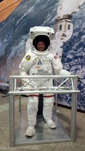 Heather Raulerson in a space suit at U.S. Space & Rocket Center