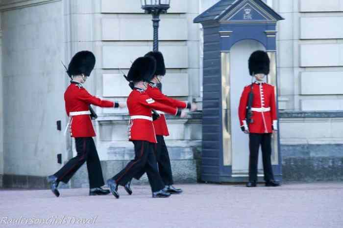 Guards marching in front of Buckingham Palace