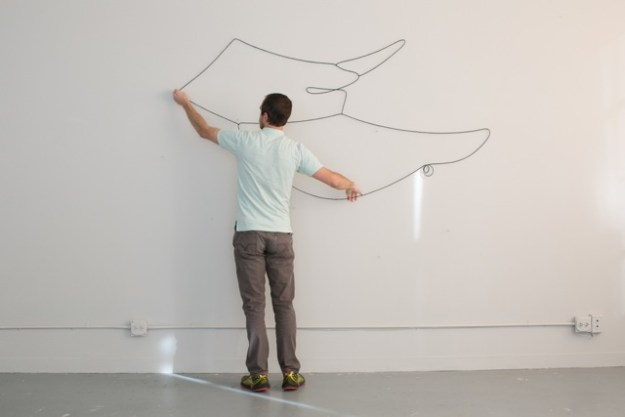 Hanging Drawing, 20 successive drawings , unique and unrehearsed, 2015. Lead,rubber,acrylic, hardware; dimensions variable