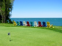 Colorful chairs on the lake