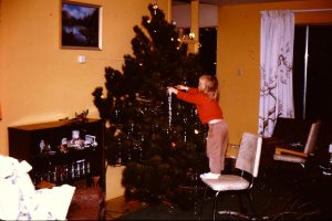A little me decorating the Christmas Tree.