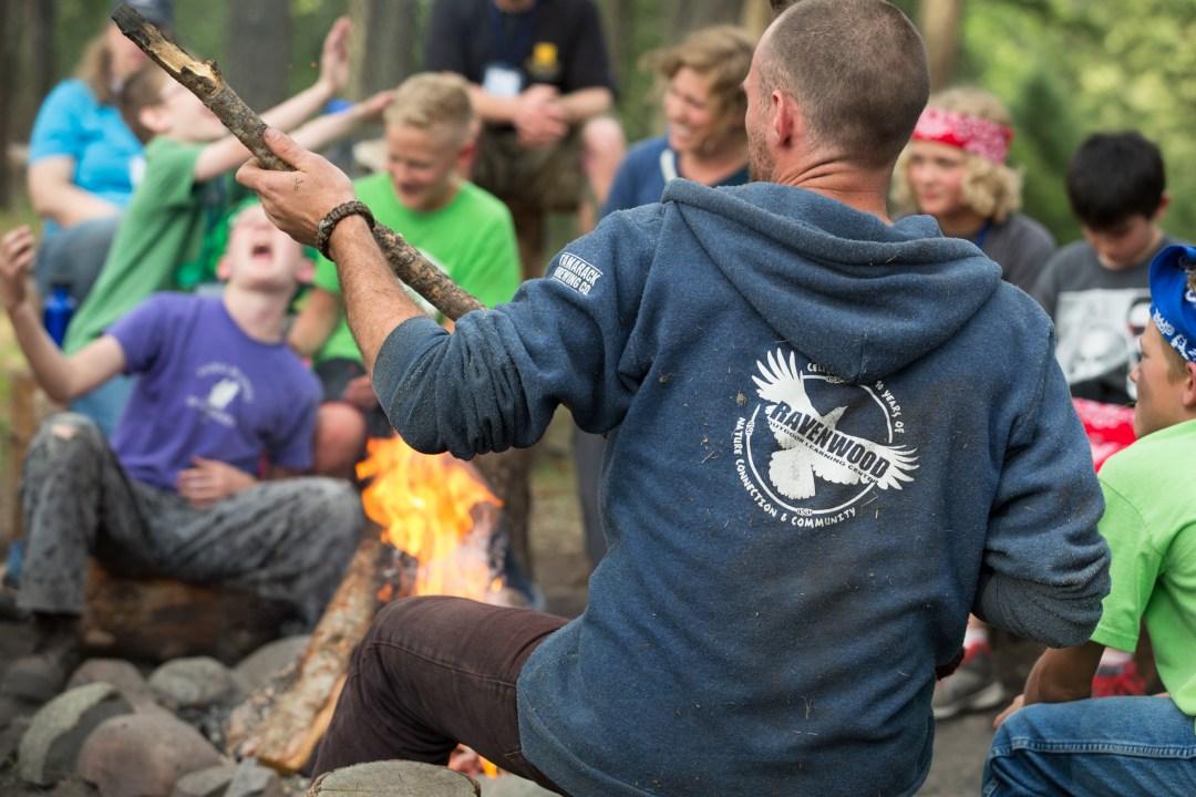 Ravenwood.kids.nature.camp.fire.airguitar