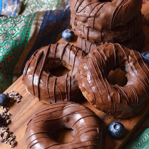 Raw almond butter, cinnamon and blueberry doughnut, covered in an almond butter, maple syrup and cinnamon glaze.