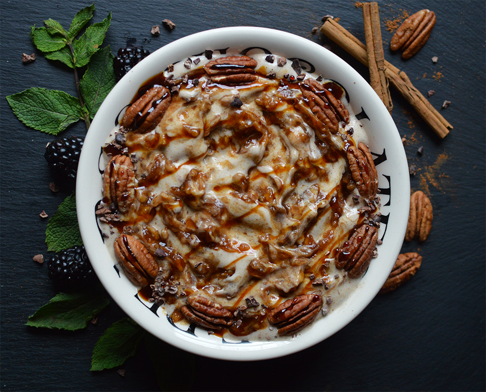 Cinnamon nicecream, swirled with caramel apple sauce, and topped with pecans and delicious coconut syrup.
