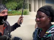 "Watch: White Protester Tells Dr. Stella Immanuel ""I'm More Black Than You"""