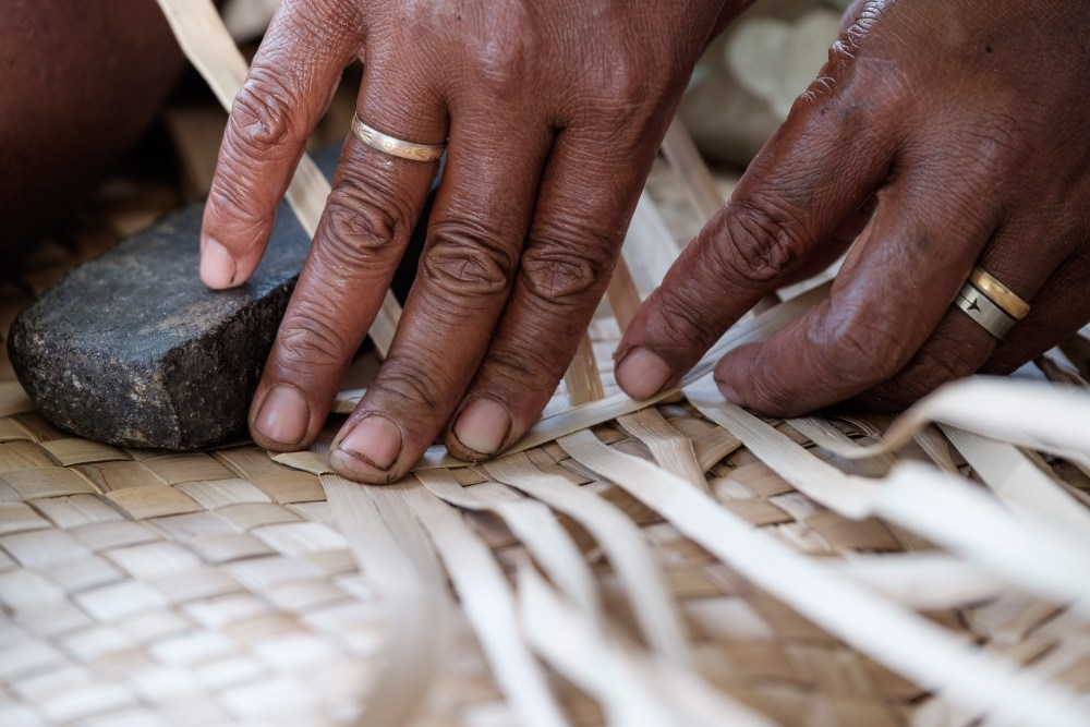 Weaving a mat in Rara village, Ba