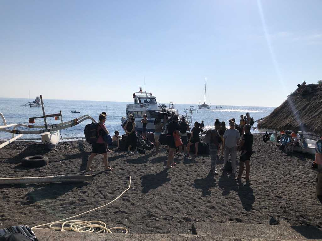 waiting for a speed boat at Amed beach
