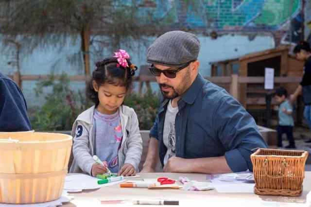 Family Studio Workshop: Los Angeles Murals at Hauser & Wirth in Downtown Los Angeles. Participants combine watercolor paint and tape to make miniature murals that represent feelings associated with Los Angeles.