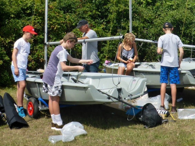 The team checking out their boats, making sure they are all up to spec!