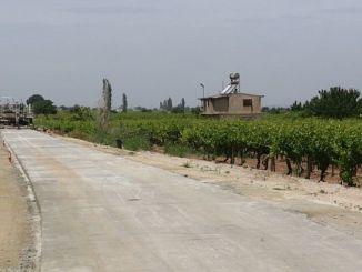 manisada asphalt road instead of concrete road