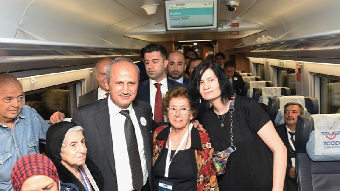 minister turhan yht and a group of elderly and disabled disabled in konyla
