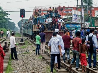 bangladeste in the train tracks was the person who walked with headphones
