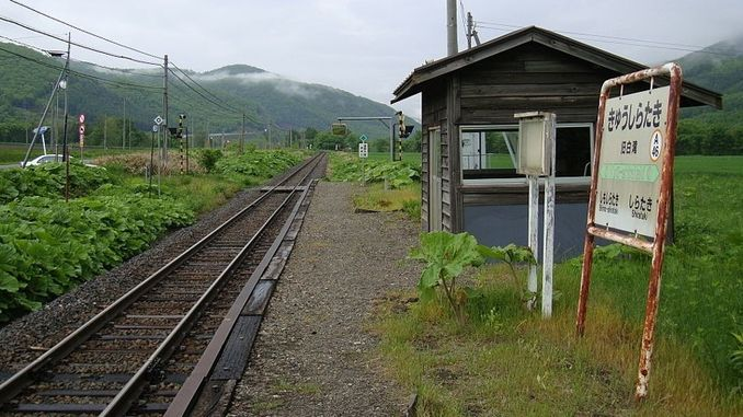 Train Station with a Single Passenger