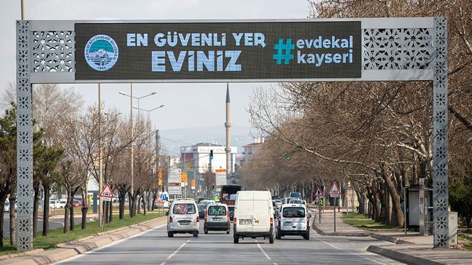 stay at home warning from traffic lights and digital signage in Kayseri