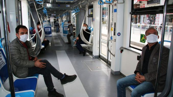 Free mask is distributed to those using mass transportation in Antalya