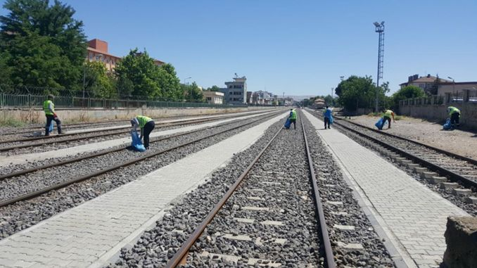 environmental cleaning along the railway route at sunset