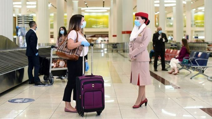 emirates covers covid costs for passengers
