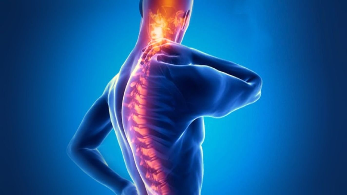 What is ankylosing spondylitis? What happens if not treated? What are the symptoms and treatment?