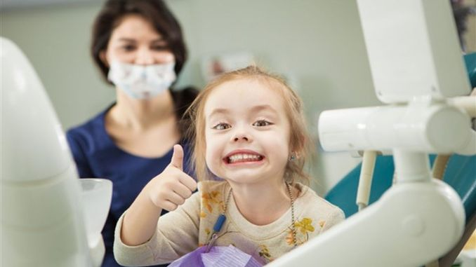 In children, the first dental examination should be done with the first tooth