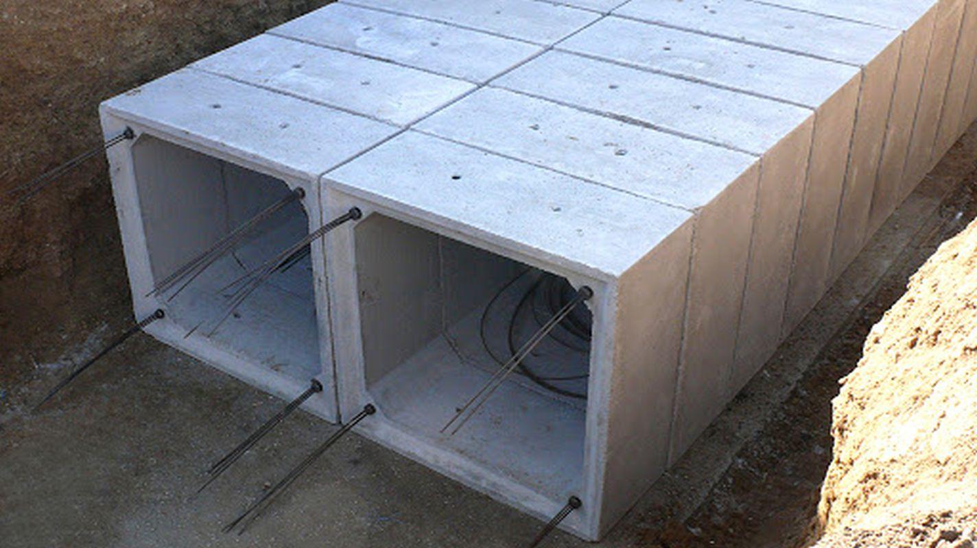 Raudoitettu betonilaatikon rumpu ja avoimen U-kanavan rakennustyöt