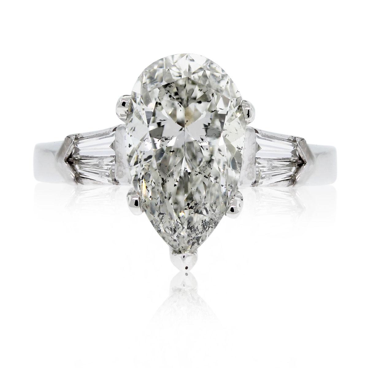 Platinum 347ct Pear Shape And Baguette Diamond Engagement