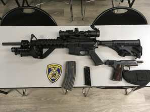 An AR-15 rifle and a handgun were seized after a Raynham man was allegedly found to have them inside a stolen car on Wednesday. (Raynham Police)