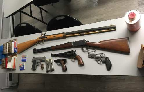 Multiple guns were seized from a home in Raynham after a man allegedly made threats to harm himself and others and barricaded himself inside the house Monday night, Jan. 1. (Raynham Police)